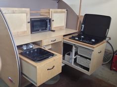 Pull-out sink and dish strainer on top. Sandra Brandes posted on Teardrop Camper Group (Facebook).