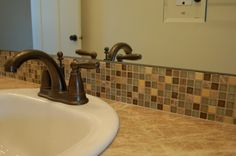green glass bathroom backsplash tile | mixture of ceramic used for the sink and tub surround. All with a ...