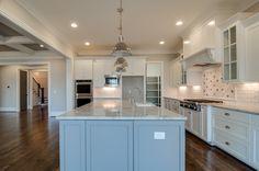 Painted Cabinets, Granite Counters, Gas Range Top, Island Pendants.