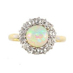 This ring is one of those pieces that makes you realise that dreams can come true. The opal is electric in colour and exudes ethereal elegance and angelic charm.