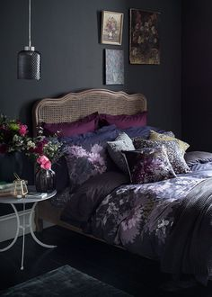 This moody floral bedroom idea is a lesson in dark romance. Bring autumn's ric… This moody floral bedroom idea is a lesson in dark romance. Bring autumn's rich colours inside with painterly prints, jewel tones and luxe metallic accents. Floral Bedroom, Bedroom Colors, Purple Bedroom Decor, Pretty Bedroom, Deco Violet, Jewel Tone Bedroom, Beautiful Bedrooms, Dark Romantic Bedroom, Dark Cozy Bedroom