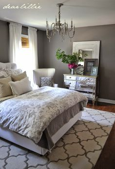 gray white bedroom. Beautiful but I would want a fancier chandelier.