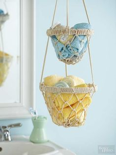 Rediscover the '70s craft of macrame with this fresh take on a hanging basket. Use cotton cording and embroidery hoops to make the baskets. A cross knot forms the base of the baskets, followed by a series of square knots. Tie cord around embroidery hoops to secure the baskets, then hang from an S-hook.