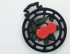 Hey, I found this really awesome Etsy listing at https://www.etsy.com/listing/186258899/cast-iron-trivet-red-cherry-hand-painted