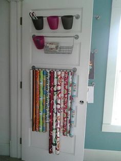 Craft Room Remodel : Closet Door - gift wrapping station by TheCraftyBlackbird, via Flickr