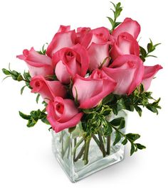 This intoxicating arrangement is the perfect blend of sweet femininity  and unabashed confidence! Our luxurious Pink Infatuation bouquet -  consisting of a dozen hot pink roses - is sure to send that special  someone straight to Cloud Nine!   Twelve hot-pink roses and oregonia burst from this modern arrangement in a rectangular glass vase.