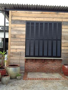 "Bermuda shutters (bifold) hanging from track system. Over 90"" tall"