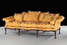 An extremely rare and important fine quality mid 18th century (c.1755) carved mahogany three seater settee attributed to the Yorkshire cabinet makers Wright and Elwick having a serpentine shaped back with out-scrolled arms and squab cushion upholstered in tangerine silk damask, having serpentine shaped moulded rails carved with c-scrolls and acanthus clasps; on eight cabriole legs with acanthus clasp to the knees, terminating in acanthus carved scroll toes.