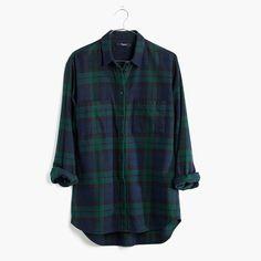 A flannel version of our favorite button-down shirt with a cool slit shirttail hem. An easy, oversized shape in a tartan plaid. <ul><li>Slightly oversized.</li><li>Cotton.</li><li>Machine wash.</li><li>Import.</li></ul>