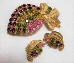 Mid Century multi color rhinestone flower bud brooch and earrings jewelry set Purple, pink and green rhinestones in a gold tone setting Brooch is 2 1/8 x 1 1/2 inches Clip ... #gotvintage