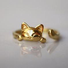 Gold cat ring, Adjustable ring, Gold plated Sterling Silver, Cat lover, cat jewelry, kitty cat ring, dainty ring, Beautiful dainty engraving details. * ONE SIZE - Adjustable ring* The models size - 6.5 Always keep a happy cat with you wherever you go with this adorable gold plated sterling silver cat ring. This fun little cat ring is perfect to wear on its own to add just a touch of kitty cat style to your everyday outfits or to stack with other rings for a wonderful Hodge podge of style…