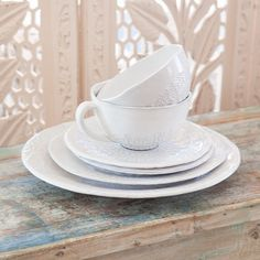 Our beautiful Bianco Ceramics have been handcrafted in Portugal. The organic shapes give a rustic, casual feel to the intricate lace patterns pressed into the design.