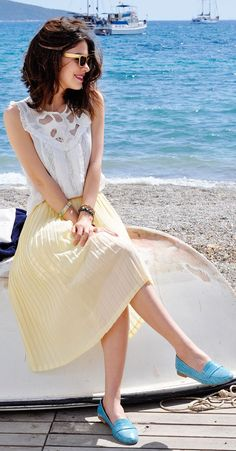Shop this look on Lookastic: https://lookastic.com/women/looks/sleeveless-top-midi-skirt-loafers-sunglasses-bracelet/10828 — Beige Sunglasses — White Lace Sleeveless Top — Yellow Pleated Midi Skirt — Mint Bracelet — Aquamarine Leather Loafers