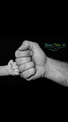 Newborn dad and son fists photo