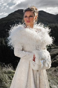 Snow Queen.  Crushed silk velvet coat with silver metallic embroidery.  Made to measure in a choice of colours.  Ostrich feather cape and faux fur muff with diamante buckle and trim.