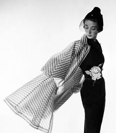Dorian Leigh in a coat designed by Bonnie Cashin, hat by John Frederics. Photo: Cecil Beaton for Vogue, April 1950.