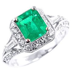 emerald green engagement ring not the typical diamond.