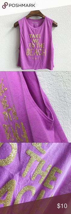 """Decree Cropped Muscle Tank Pre-loved but in good condition. Very minor wear, but no stains, snags, or tears. (0300)   PRODUCT DETAILS: •Size: Large •Colors: Purple, Gold •Made in Vietnam •Measurements: Chest-19inch Length-20inch •65% Polyester, 35% Rayon •Machine Wash •Cropped Muscle Tank Style •Glitter Graphics •Crew / Scoop Neck •Quote """"Take me to the beach""""   Tags: summer Top blouse shirt sparkle bling Decree Tops Muscle Tees"""