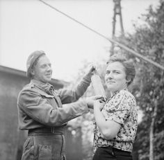 pinner writes: THE LIBERATION OF SANDBOSTEL CONCENTRATION CAMP, MAY 1945. A Royal Army Medical Corps orderly dusting a former female inmate of the Sandbostel Concentration Camp with DDT powder. Prevention of diseases, such as typhus, among the huge numbers of displaced persons in the North West Europe became an important priority for the RAMC.