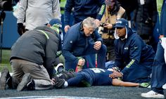 SEATTLE, WA - DECEMBER 24:  Head coach Pete Carroll of the Seattle Seahawks tends to wide receiver Tyler Lockett #16 after he was injured in a play against the Arizona Cardinals at CenturyLink Field on December 24, 2016 in Seattle, Washington.  (Photo by Steve Dykes/Getty Images)