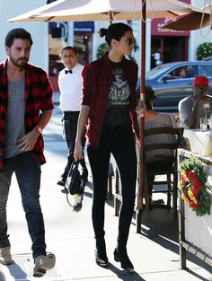 Kendall Jenner wearing a band tee and flannel shirt