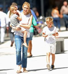 Kelly Rutherford and her two children.  I like her pants....