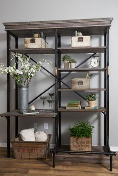 This open shelf bookcase is perfectly styled by Joanna Gaines of HGTV's Fixer Upper....So industrial!  |  Friday Favorites Styled Shelves from www.andersonandgrant.com