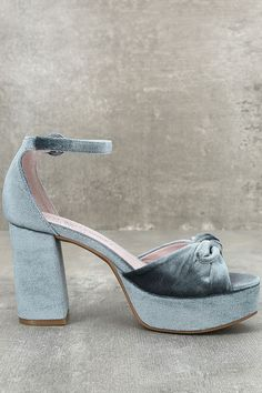Head to high tea or the after party in the Chinese Laundry Tina Steel Blue Velvet Platform Heels! Soft velvet knots atop a peep-toe upper, while a matching heel cup and adjustable ankle strap (with covered buckle) complete the look.