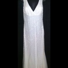 Ivory Wedding Dress *Never Worn* Simple, but elegant Floor length Tulle A-Line with lace embroidery and delicate beading fully lined with a side zip made by Jessica Designs ITNL Comes with extra beads. Perfect for destination or casual wedding! *Note* This dress runs very small and; fits more like an 8 or 10 Tag - Size 12 Jessica Designs ITNL Dresses Maxi
