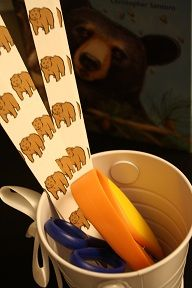 Scissor practice cutting bear strips (use with We're Going on a Bear Hunt)