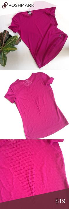 Nike Dri Fit Perforated Back Shirt Dri fit t-shirt with perforated back from Nike. Size: M. Color: Magenta. Breathable back and arm pit. 92% polyester, 8% spandex. Nike Tops Tees - Short Sleeve