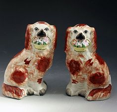 PAIR ANTIQUE STAFFORDSHIRE POTTERY SPANIELS WITH BASKETS