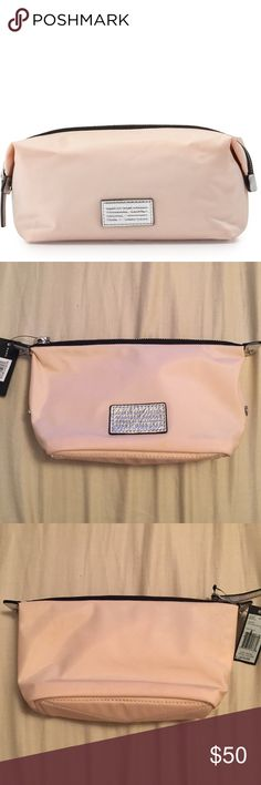 """Marc Jacobs Landscape Cosmetic Pouch  New with tag. Can be used buttoned, like first image, or unbuttoned. Pearl pink color. MARC by Marc Jacobs nylon pouch bag. Contrast leather trim; nickel hardware. Metallic logo applique at front. Extended zip-top closure. 5.5""""H x 8.5""""W x 3""""D. Marc by Marc Jacobs Bags Cosmetic Bags & Cases"""