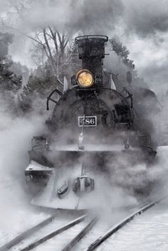 Steaming through the snow by Eric Wulfsberg - steam train no 486