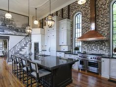 Beautiful Kitchen in a historical home... Among the kitchen's noteworthy features are impressive high ceilings, antiqued and hand-painted finishes, and a large antique Chinese print | via hgtvremodels.com...
