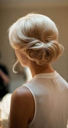 . pretty rolled chignon .i want my hairlike this for kaleb and Hannah's wedding