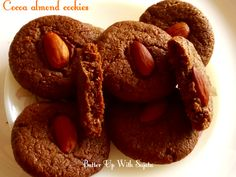 Cocoa almond cookies.  A delicious, crispy and little chewy cookies. A perfect snack for your kiddos. Absolutely healthy. Kids will love it's taste.  I have mixed three types of flo…
