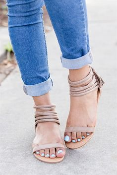 Check out these beautiful strapped, open toe, sandals that are ideal for your entire summer/spring closet. Crafted with faux suede, and features an edgy backside fringe tassel.