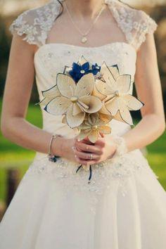 handmade ivory and navy origami flowers.