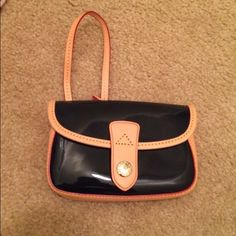 Dooney and Burke Patent Leather Wristlet New used Navy Blue patent leather wristlet! Perfect condition! Dooney & Bourke Bags Clutches & Wristlets