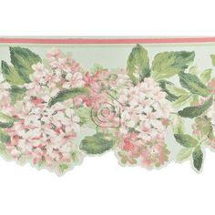 Cenefa de hortensias en tonos rosas y blancos con hojas verdes y fondo verde agua.   La cenefa tiene el borde inferior troquelado siguiendo el contorno del motivo floral lo que acentúa su estilo romántico – clásico.