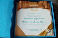 Beautiful turquoise and gold silk invitation by Marshay Invitation Boutique.
