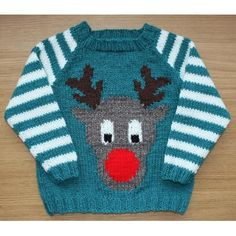 Rudi was born from a friend asking if we minded her wearing an awful Christmas jumper to our Christmas dinner. Of course no one minded. Then it got competitive; who could come up with the most awesome Christmas jumper? So I decided that knitting one for my son would be an excellent challenge, and be rather quicker than knitting an adult sized one!Knitted flat in aran weight yarn, this raglan sweater features an intarsia reindeer on the front. The instructions cover three sizes, 2–3 (22 inch…