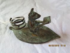 Candle Holder Mouse Reading Book. Measures about 2 high, 4 1/4 wide and 2 1/2 deep. For additional photos, feel free to contact us. Our items are sold for the Estate or the family of the Estate. Wendell Keefer Estate Sales in Fontana California sell's thousands of items online. We