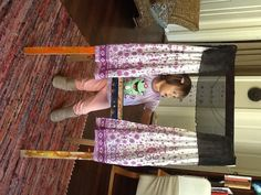 Up-cycled ikea easel. puppet stage with pull string curtains.