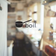 This food magazine logo cleverly uses a simple boiling pot as its symbol which complements the title. Blurred background of a chef in the kitchen tells the reader a lot about the subject matter.