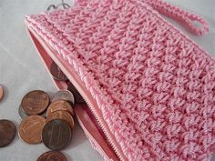 A crochet stitch with the texture of wicker gives this crocheted coin purse  amazing texture and style. Crochet pattern download from Craftsy.