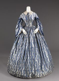 Wedding Dress Date: ca. 1860 Culture: American Medium: silk, cotton Dimensions: Length at CB: 58 in. (147.3 cm) Credit Line: Brooklyn Museum Costume Collection at The Metropolitan Museum of Art, Gift of the Brooklyn Museum, 2009; Gift of the Jason and Peggy Westerfield Collection, 1969