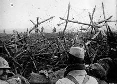 German soldiers (rear) offering to surrender to French troops, seen from a listening post in a trench at Massiges, northeastern France