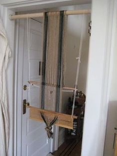 Clever way to warp a backstrap loom with a rigid heddle.... Doorway? I don't need a doorway...